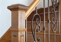 Wood stairs newel handrail staircase home interior classic victorian style. Hardwood newel post staircase classic style interior steps stairway design Stock Photo