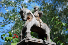 Wood statue representing a horserider Royalty Free Stock Images