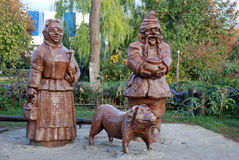Wood statue of ukrainian peasants. In garden Royalty Free Stock Photography