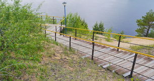 Wood and steel stairs down to river. Wood and steel stairs down to Volga river Stock Photography