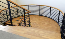 Wood and steel stairway in a modern building with parquet Stock Images