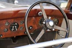 Wood steering wheel Stock Images