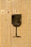 Wood stencil. Wooden crate detail with wine glass stencil painted on Royalty Free Stock Image