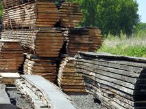 Wood stockpile. A stockpile of wood planks and boards in a lumber yard Stock Image