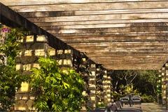 Wood stone pergola sunny day botanical gar Royalty Free Stock Photo