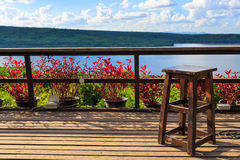 Wood stool on balcony in lake Stock Images