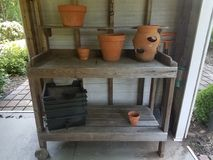 Wood storage rack with clay or terracotta pots. A wood storage rack or shelf with clay or terracotta pots royalty free stock images