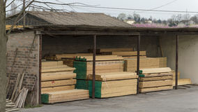 Wood stored in small warehouse Royalty Free Stock Images