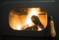 Wood stove. And wood burning inside Royalty Free Stock Photo