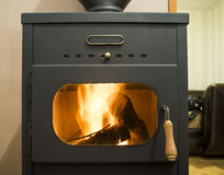 Wood stove. And wood burning inside Stock Image