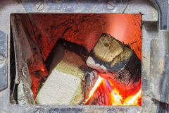 Wood stove firebox with fire and wood 3 Royalty Free Stock Photos