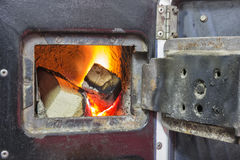 Wood stove firebox with fire and wood 2 Stock Images