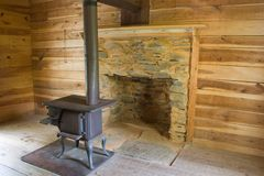 Wood Stove in Log Cabin_4913-1S. Wood Burning Stove Pictured Inside an Old Log Cabin royalty free stock photos