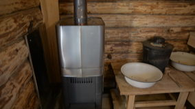 Wood stove in the Russian bath stock footage