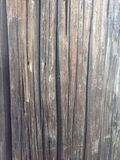 Wood street pole texture. Vertical lines of a wooden street post Royalty Free Stock Photos