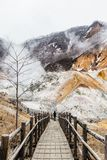 Wood structure walk way of Noboribetsu Jigokudani Hell Valley: The volcano valley got its name from the sulfuric smell. Wood structure walk way of Noboribetsu royalty free stock image