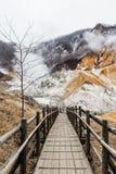 Wood structure walk way of Noboribetsu Jigokudani Hell Valley: The volcano valley got its name from the sulfuric smell. Wood structure walk way of Noboribetsu stock images