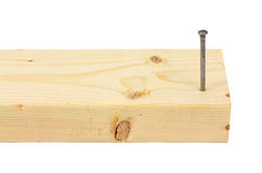 Wood stud with nail. The end of a wood stud with a framing nail started royalty free stock photos