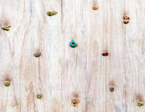 The wood surface of an artificial rock climbing wall with hand a Stock Image