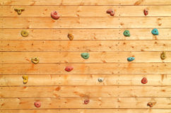 The wood surface of an artificial rock climbing wall. Royalty Free Stock Photo
