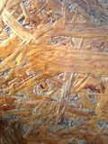 Wood surface of the bench. Sharp, pressed wood on the bench, polished but textured, shades of light brown stock image