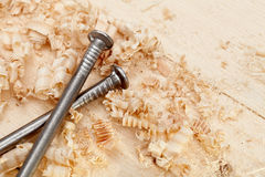 Wood surface, shavings and nails Stock Image