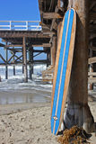 Wood surfboard against California beach pier. Wall Art wood surfboard against pier. Made by local artist Royalty Free Stock Images
