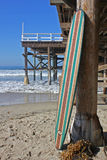 Wood surfboard against California beach pier. Wall Art wood surfboard against pier. Made by local artist Royalty Free Stock Image
