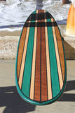 Wood surfboard against California beach pier. Wall Art wood surfboard against pier. Made by local artist Stock Photography