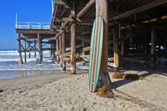 Wood surfboard against California beach pier. Wall Art wood surfboard against pier. Made by local artist Stock Images