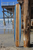 Wood surfboard against California beach pier. Wall Art wood surfboard against pier. Made by local artist Stock Photos