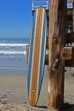 Wood surfboard against California beach pier. Wall Art wood surfboard against pier. Made by local artist Stock Photo