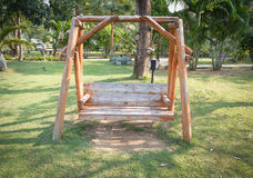 Wood swing bench Royalty Free Stock Images
