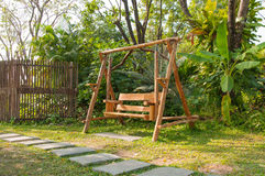Wood swing bench in a park. Tropical natural Stock Photo
