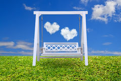 Wood swing chair with beautiful cloud Stock Images