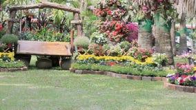 Wood swing in the flowers garden, HD vdo. stock video
