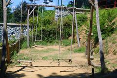 Wood Swing. Outside swing set. Swing. Outside swing set. Wooden swing in the forest in summer royalty free stock photo