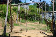 Wood Swing. Outside swing set. Swing. Outside swing set. Wooden swing in the forest in summer royalty free stock image