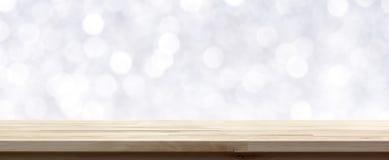 Wood tabellöverkant på abstrakt vit bokehbakgrund Arkivfoto