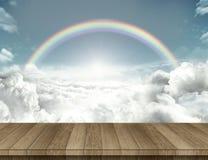 Wood tabell med med regnbågen Arkivfoton