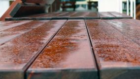 Wood table #. Details of the wooden table with rain droops royalty free stock image