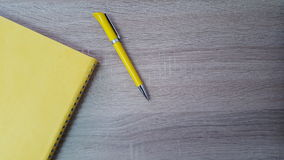Wood table background with pen and agenda stock images