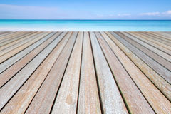 Wood table on the beach and blue sky. royalty free stock images