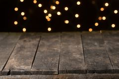 Wood table with black background round lights royalty free stock images