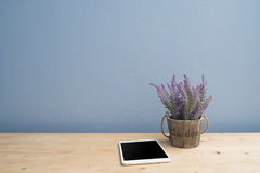 Wood table with blank screen  smartphone and purple lavender flower on flowerpot. Royalty Free Stock Images
