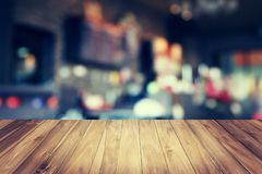 Wood table and blur cofee shop. Background stock photos