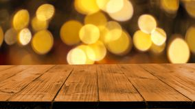 Wood table on bokeh background Royalty Free Stock Images