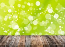 Wood table with bokeh blur background Royalty Free Stock Photo
