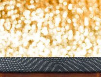 Wood Table with bokeh golden sparkling background,Empty room for Royalty Free Stock Photos