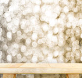 Wood Table with bokeh golden sparkling background,Empty room for. Display your product Royalty Free Stock Photography